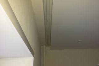 Натяжные потолки с нишей под гардину